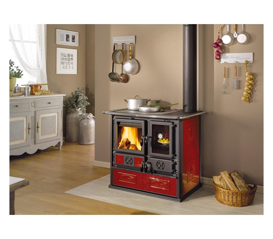 Cucina a legna rosa reverse la nordica extraflame - Cocina rosa ...